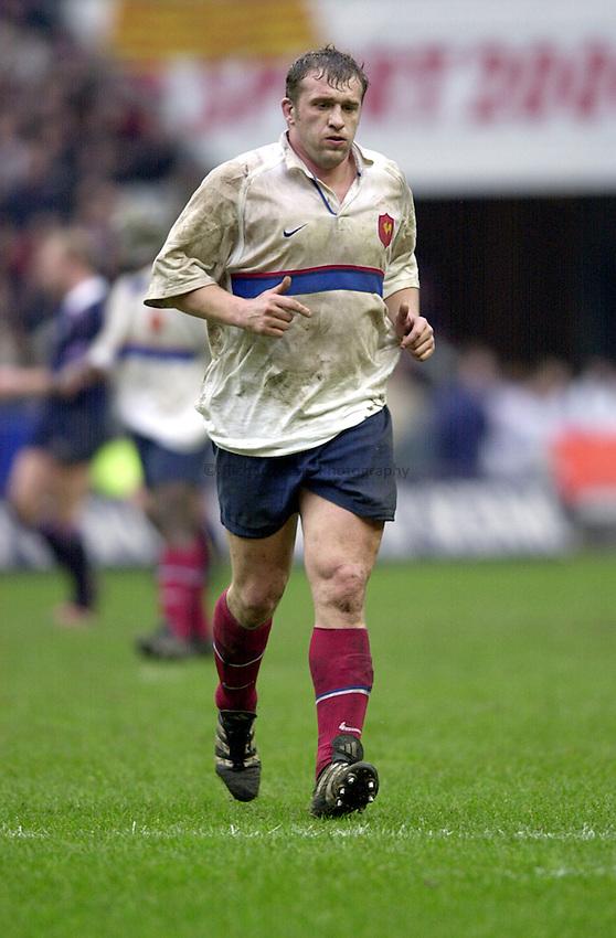 Photo Richard Lane..France v Scotland.Lloyds T.S.B Six Nations Championship 2001..Stade de France. 04.02.2001.Christophe Juillet in action for the French.