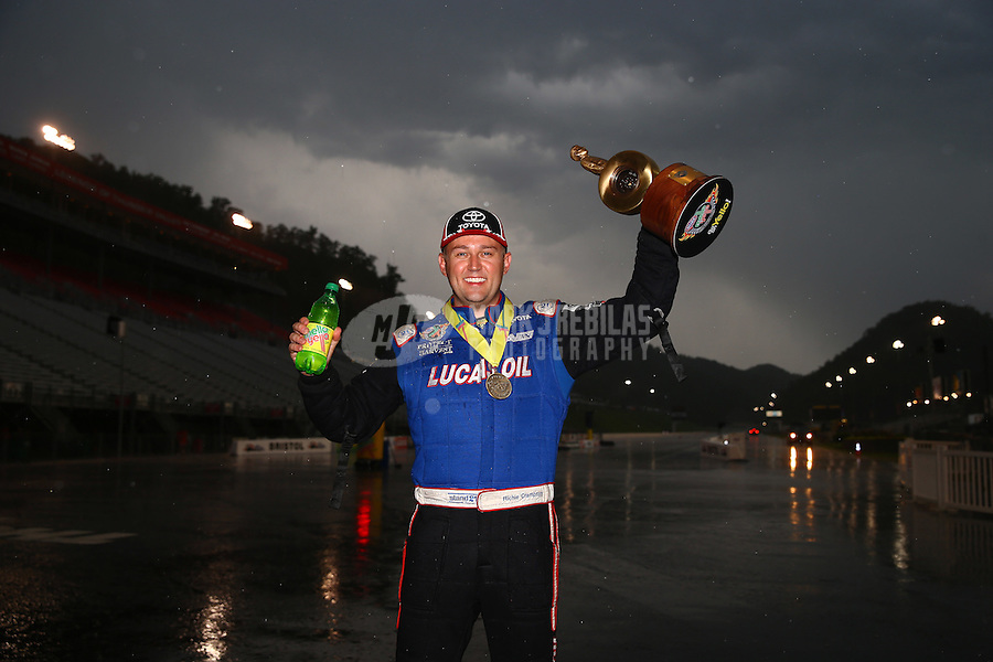 Jun 21, 2015; Bristol, TN, USA; NHRA top fuel driver Richie Crampton celebrates in the rain after winning the Thunder Valley Nationals at Bristol Dragway. Mandatory Credit: Mark J. Rebilas-