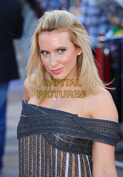 """Rebecca Ferdinando .The UK Premiere of """"Cowboys And Aliens"""", O2 Arena, London, England..11th August 2011.headshot portrait blue white brown stripe off the shoulder. CAP/BEL.©Tom Belcher/Capital Pictures."""