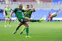 Shane Geraghty of London Irish clears as Alex Waller of Northampton Saints attempts to block during the Premiership Rugby match between London Irish and Northampton Saints at the Madejski Stadium on Saturday 4th October 2014 (Photo by Rob Munro)