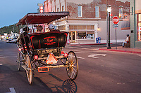 Carrige rides in downtown Williams Arizona, a Route 66 town.