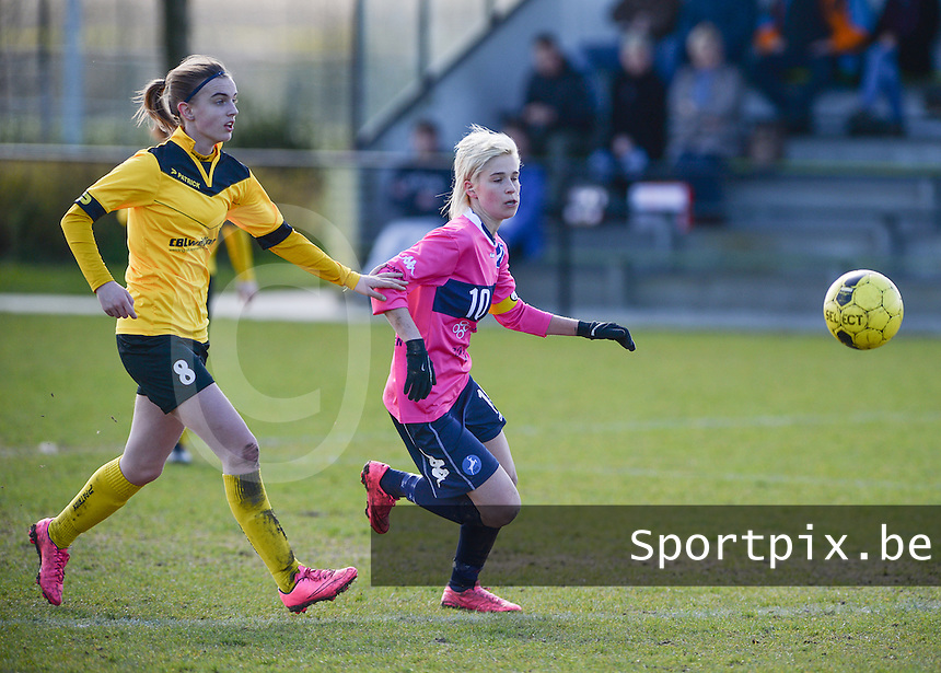 20160328 - Zwevezele , BELGIUM : Turnhout's Stephanie Van Gils pictured with Zwevezele's Ellen Lagrange (left) during the soccer match between the women teams of Voorwaarts Zwevezele and FC Turnhout  , on the 20th matchday of the Belgian Third division for Women on Saturday 28 th March 2016 in Zwevezele .  PHOTO SPORTPIX.BE DAVID CATRY