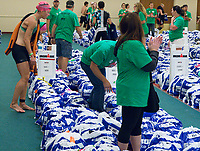 Volunteers help athletes find their biking gear during the 2017 IRONMAN Wisconsin on Sunday, September 10 in Madison