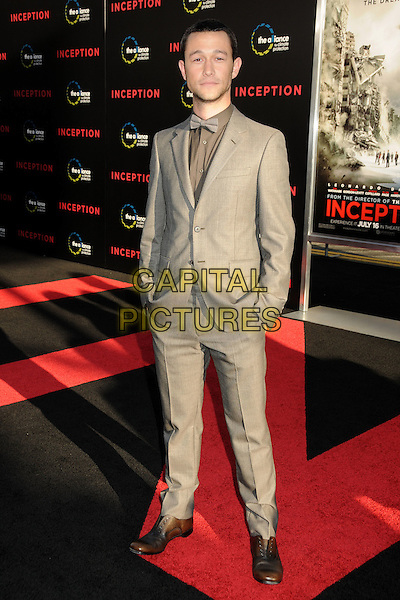 "JOSEPH GORDON-LEVITT .""Inception"" Los Angeles Film Premiere held at Grauman's Chinese Theatre, Hollywood, California, USA, .13th July 2010..full length suit tuxedo tux hands in pockets grey gray bow tie shirt brown shoes beige .CAP/ADM/BP.©Byron Purvis/AdMedia/Capital Pictures."