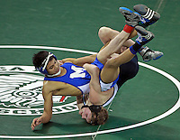 Lowelll, MA  -  Methuen High's Sarith Has (top) wrestles St. John's Prep's DJ Lemieux in the 120 lb bout of the MIAA team wrestling finals at Tsongas Center on Monday, February 20, 2012. Methuen finished the year undefeated as state champs.