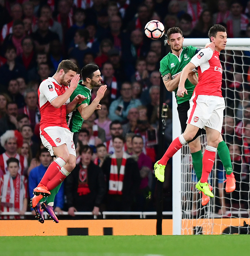 Lincoln City's Luke Waterfall vies for possession with Arsenal's Laurent Koscielny<br /> <br /> Photographer Chris Vaughan/CameraSport<br /> <br /> The Emirates FA Cup Quarter-Final - Arsenal v Lincoln City - Saturday 11th March 2017 - The Emirates - London<br />  <br /> World Copyright &copy; 2017 CameraSport. All rights reserved. 43 Linden Ave. Countesthorpe. Leicester. England. LE8 5PG - Tel: +44 (0) 116 277 4147 - admin@camerasport.com - www.camerasport.com