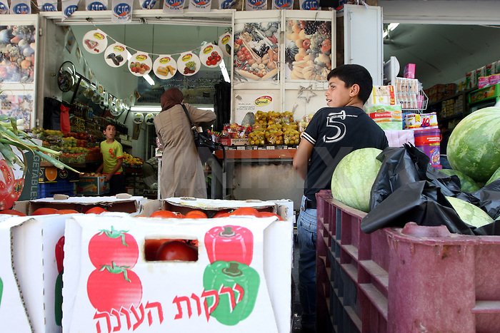 Portrait of Mawid, a 13 year-old Palestinian boy who works in one of the markets in east Jerusalem's old city. July 14, 2008. .Photo by : Tess Scheflan/ JINI