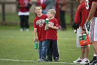11 April 2007: Kids offer water bottles to the players during spring practice at the practice field in Stanford, CA.