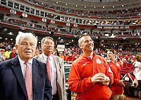 Reds owner Bob Castellini, Jeff Wyler and Urban Meyer watch the video board as Ohio State football players and coaches walk on the field carrying an American flag prior to the Cincinnati Reds game against Pittsburgh at Great American Ball Park on Wednesday, April 8, 2015. (Columbus Dispatch photo by Jonathan Quilter)