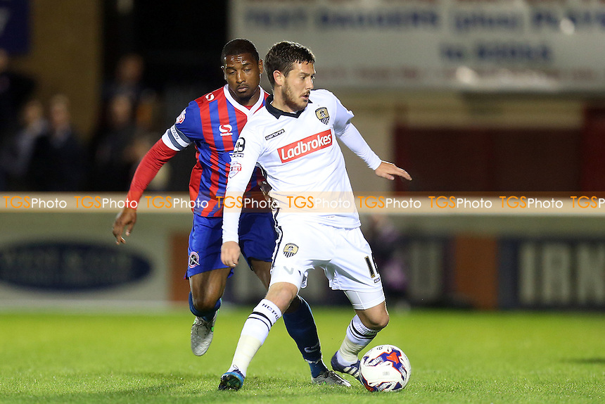 Liam Noble of Notts County and Andre Boucaud of Dagenham during Dagenham and Redbridge vs Notts County, Sky Bet League 2 Football at the Chigwell Construction Stadium, London, England on 29/09/2015