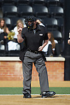 Home plate umpire Wilson Raynor makes a strike call during the ACC baseball game between the Louisville Cardinals and the Wake Forest Demon Deacons at David F. Couch Ballpark on March 18, 2018 in  Winston-Salem, North Carolina.  The Demon Deacons defeated the Cardinals 6-3.  (Brian Westerholt/Sports On Film)