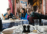 USA, Colorado, Aspen, couple eating fondue at the Cloud Nine Restaurant, Highlands Ski Resort