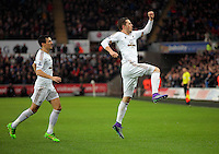 Gylfi Sigurdsson of Swansea (R) celebrates his opening goal during the Barclays Premier League match between Swansea City and Crystal Palace at the Liberty Stadium, Swansea on February 06 2016