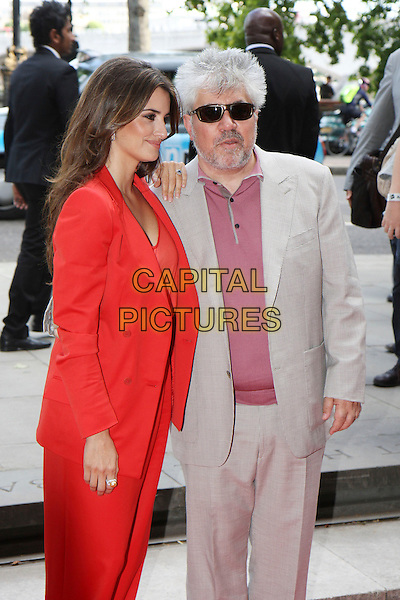 "PENELOPE CRUZ  & PEDRO ALMODOVAR .Attending the UK Film Premiere of ""Broken Embraces"" (Los Abrazos Rotos) at Somerset House, London, England, UK, July 30th 2009..half length sunglasses shirt t-shirt grey gray blazer suit director red jacket shoulder pads catsuit pantsuit jumpsuit checked check gingham .CAP/MAR.©Martin Harris/Capital Pictures"