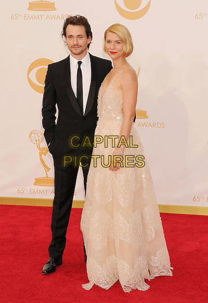 Hugh Dancy &amp; Claire Danes<br /> The 65th Annual Primetime Emmy Awards - Arrivals held at The Nokia Theatre L.A. Live in Los Angeles, California, USA.<br /> September 22nd, 2013<br /> full length suit dress white cream lace plunging neckline cleavage married husband wife black <br /> CAP/ROT/TM<br /> &copy;Tony Michaels/Roth Stock/Capital Pictures