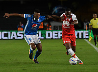 BOGOTA - COLOMBIA - 22 – 01 - 2018: Sebastian Ayala (Der.) jugador de Millonarios disputa el balón con Juan David Valencia (Izq.) jugador de Independiente Santa Fe, durante partido entre Millonarios y el Independiente Santa Fe, por el Torneo Fox Sports 2018, jugado en el estadio Nemesio Camacho El ampin de la ciudad de Bogota. / Sebastian Ayala (R) player of Millonarios vies for the ball with Juan David Valencia (L) player of Independiente Santa Fe, during a match between Millonarios and Independiente Santa Fe, for the Fox Sports Tournament 2018, played at the Nemesio Camacho El Campin stadium in the city of Bogota.Photo: VizzorImage / Luis Ramirez / Staff.