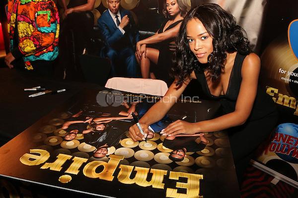 NEW YORK, NY - MAY 14, 2016 Serayah signs autographs at the Empire Season 2 release cd signing at Planet Hollywood, May 14, 2016. Photo Credit: Jamel Johnson / Media Punch