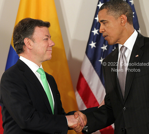 United States President Barack Obama (R) shakes hands with President Juan Manuel Santos Calderon of Colombia at a bilateral meeting, Friday, September 24, 2010 in New York City. Obama has been in New York since Wednesday attending the annual General Assembly at the United Nations, where yesterday he stressed the need for a resolution between Israel and Palestine, and a renewed international effort to keep Iran from attaining nuclear weapons.  .Credit: Spencer Platt - Pool via CNP
