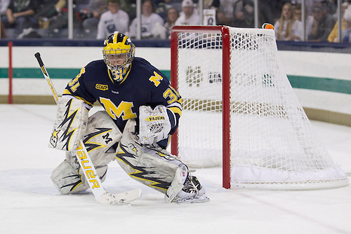 Michigan goaltender Shawn Hunwick (#31) in second period action of NCAA hockey game between Notre Dame and Michigan.  The Notre Dame Fighting Irish  defeated the Michigan Wolverines 3-1 in game at the Compton Family Ice Arena in South Bend, Indiana.