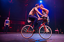 London, UK. 10.04.2014. Australian circus ensemble, Company 2, bring SHE WOULD WALK THE SKY to the Roundhouse, as part of CircusFest 2014. Picture shows: David Carberry (The Strong Man - bike), Daniel Catlow (A Gate Keeper) and Jessica McCrindle (A Gatekeeper). Photograph © Jane Hobson.