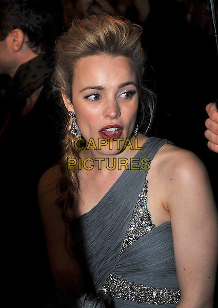 "RACHEL McADAMS.At the ""Sherlock Holmes"" World Premiere, Odeon Leicester Square, London, England, UK, .December 14th 2009..portrait headshot grey gray one shoulder earrings hair plait braid  jewel encrusted beaded crystals jewelled embellished mouth open .CAP/IA.©Ian Allis/Capital Pictures."