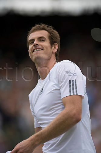 26.06.2013. The Wimbledon Tennis Championships 2013 held at The All England Lawn Tennis and Croquet Club, London, England, UK. Murray throws his wrist bands to the crowd after the game between Andy Murray (GBR) [2] v Yen-Hsun Lu (TPE)  on No 1 Court.