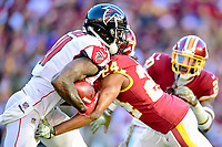 Landover, MD - November 4, 2018: Atlanta Falcons wide receiver Julio Jones (11) is tackled by Washington Redskins cornerback Josh Norman (24) during game between the Atlanta Falcons and the Washington Redskins at FedEx Field in Landover, MD. The Falcons defeated the Redskins 38-13. (Photo by Phillip Peters/Media Images International)