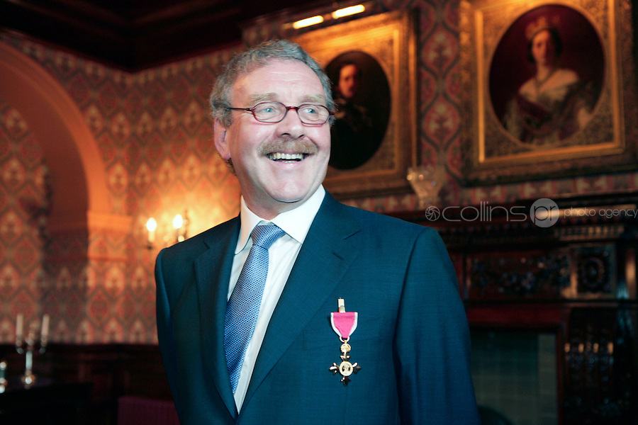 22/6/10 Michael Colgan recieves his OBE from Ambassador Julian King at the British Amabassador's residence at Glencairn House in Sandyford, Dublin. Arthur Carron/Collins