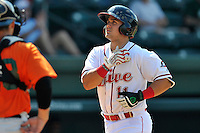 Third baseman Michael Chavis (11) of the Greenville Drive gestures after scoring a run in a game against the Augusta GreenJackets on Sunday, June 12, 2016, at Fluor Field at the West End in Greenville, South Carolina. Greenville won, 11-8. (Tom Priddy/Four Seam Images)