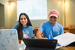 Hetal Champaneri, left, checks out her schedule as Prahar Patel studies some physics.  Photo by Kevin Bain/Ole Miss Communications