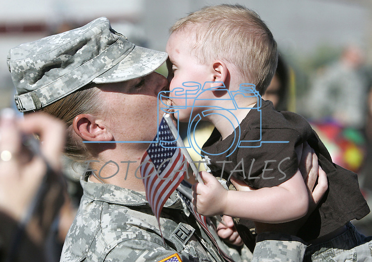 Nevada Army National Guard Staff Sgt. Jennifer Arndell gets a welcoming kiss from her 18-month-old cousin Robert Martin Sept. 1, 2007, at the Stead Training Center, near Reno, Nev. Arndell and her fellow soldiers in the 593rd Transportation Company returned after spending the previous year in Iraq..Photo by Cathleen Allison/Copyright Nevada Appeal