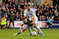 Tom Bradshaw of Millwall is fouled by Mateusz Klich of Leeds during Millwall vs Leeds United, Sky Bet EFL Championship Football at The Den on 5th October 2019