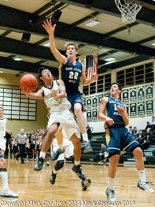 Servite's Neil Pauu gets off a shot past the long arm of San Juan Hills Vincent McFadden in Monday's North Orange County Tournament game at Servite.<br />