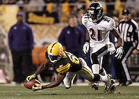 PITTSBURGH, PA - NOVEMBER 06:  Antonio Brown #84 of the Pittsburgh Steelers catches a pass in front of Ladarius Webb #21 of the Baltimore Ravens during the game on November 6, 2011 at Heinz Field in Pittsburgh, Pennsylvania.  (Photo by Jared Wickerham/Getty Images)