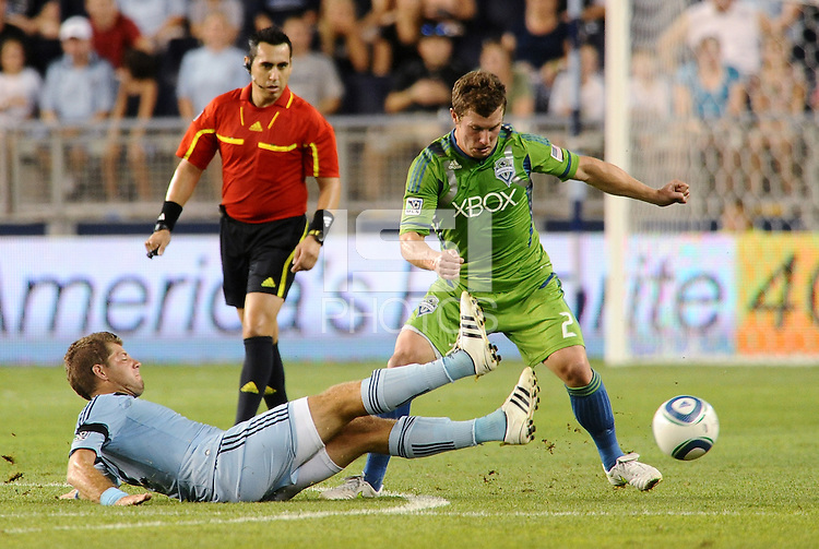 Luke Sassano (32) midfielder Sporting KC slide tackles Mike Fucito (2) forward Seattle Sounders... Sporting Kansas City were defeated 1-2 by Seattle Sounders at LIVESTRONG Sporting Park, Kansas City, Kansas.