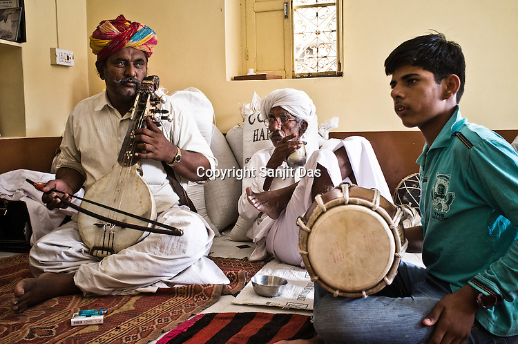 14 year old Latif Khan practices his Dholak skills with his father, Ghewar Khan in their house in Hamira village of Jaiselmer district in Rajasthan, India. Photo: Sanjit Das/Panos