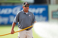 Kannapolis Intimidators head groundskeeper Billy Ball waters down the infield prior to the game against the Greensboro Grasshoppers at CMC-Northeast Stadium on June 12, 2014 in Kannapolis, North Carolina.  The Grasshoppers defeated the Intimidators 5-2.  (Brian Westerholt/Four Seam Images)