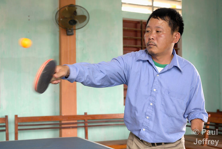 Luu Trung Truc plays ping pong at a sports club organized by landmine survivors in Ha Trach, Vietnam. .