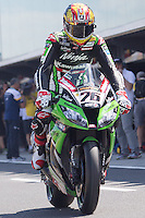 Loris Baz (FRA) riding the Kawasaki ZX-10R (76) of the Kawasaki Racing Team leaving the pits for a practise session on day one of round one of the 2013 FIM World Superbike Championship at Phillip Island, Australia.