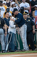 Washington DC, June 15, 2017,USA:  Since 1909, Democratic and Republican Member of the House and Senate have held an annual baseball game.  This year, due to shooting of House Majority Whip, Steve Scalise, R-LA, the teams showed their unity by wearing Capitol Hill Police ball caps to honor the officers that were wounded protecting Scalise and other Members of Congress. David Bailey, the Capitol Hill Police officer, who was wounded by protecting the Congressman during the shooting gets a hug from one of the Congressman playing in the game.  Patsy Lynch/MediaPunch