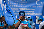 JUNE 29, 2019 - A protestor wears a mask displaying the flag of East Turkestan, symbol of Uyghur independence, at a demonstration against the Chinese government's treatment of the Uyghur ethnic group during the G20 Summit in Osaka, Japan. (Photo by Ben Weller/AFLO) (JAPAN) [UHU]
