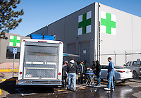 Employees of Medicine Man take a break next to the grow house in Denver, Colorado, Tuesday, March 5, 2013. With Colorado's Amendment 64, the state has been working to decide how it will transition to legalized marijuana in the state...Photo by Matt Nager
