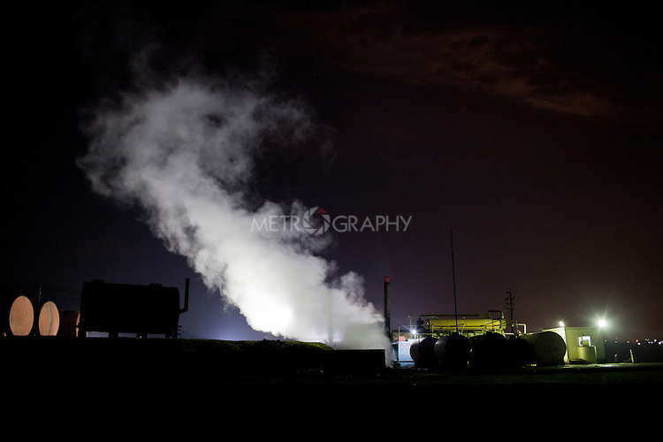 19/02/15 --TANJERO, IRAQ: Steam from the cooling bank rises above the refinery.<br /> <br /> The family of Yezidis, displaced from Sinjar, live next to an oil refinery in the Kurdish Region of Iraq. The young men run the refinery 24 hours a day with little to no safety equipment. Reporting for this article was supported by a grant from the Pulitzer Center on Crisis Reporting