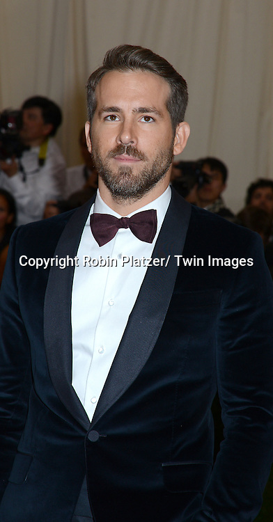 Ryan Reynolds attends the Costume Institute Benefit on May 5, 2014 at the Metropolitan Museum of Art in New York City, NY, USA. The gala celebrated the opening of Charles James: Beyond Fashion and the new Anna Wintour Costume Center.