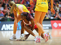 England's Ama Abgeze grabs the ball against Australia in the New World Quad series netball match, TECT Arena, Tauranga, New Zealand, Sunday, October 28, 2012. Credit:NINZ / Dianne Manson.
