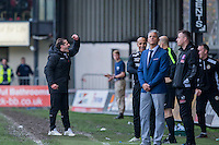 Newport County manager Graham Westley celebrates his side's win with the fans at the full time whistle as Carlisle manager Keith Curle looks to the sky during the Sky Bet League 2 match between Newport County and Carlisle United at Rodney Parade, Newport, Wales on 12 November 2016. Photo by Mark  Hawkins.