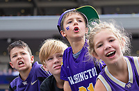Young Husky fans hope to land free goodies from the cheer squad during a timeout.