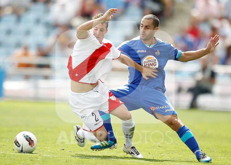 Getafe's Mehdi Lacen against Rayo Vallecano's Roberto Roman Tito during La Liga Match. September 18, 2011. (ALTERPHOTOS/Alvaro Hernandez)