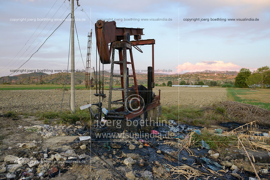ALBANIA, Fier, crude oil field and drilling pump from communist era, still operating and polluting the environment / ALBANIEN, Fier, Erdoelfoerderung, alte Oelfoerderpumpe