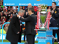 Pictured: Manchester United manager Sir Alex Ferguson (L) is being presented with a medal. Sunday 12 May 2013<br /> Re: Barclay's Premier League, Manchester City FC v Swansea City FC at the Old Trafford Stadium, Manchester.